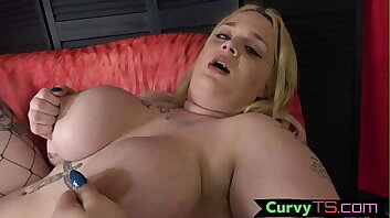 Curvy trans babe plays with her huge tits
